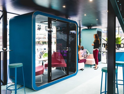 Framery Smart Office Acoustic Meeting Pod with Blue Finish and Red Chairs