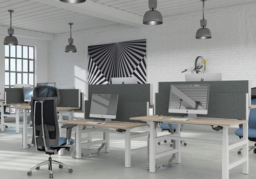 Modular Sit-Stand Desks with Black Chairs in Grey Office