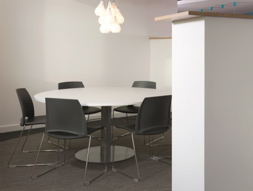 Giant Round 8 Seater Meeting Table with White Finish and Black Chairs