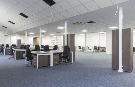 Moduslink-Office-Layout-Switch-Back-to-Back-Desks-with-Pedestals-in-Walnut-Finish-and-Black-High-Back-Office-Chairs