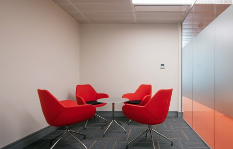 Apex-Office-Layout-Meeting-Room-Orange-Tub-Meeting-Chairs-with-Round-Glass-Table-in-Swivel-Base