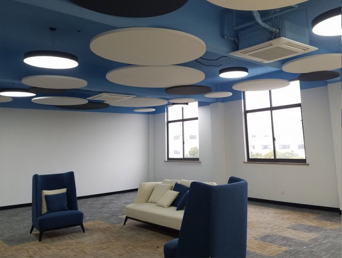 Soundtect Acoustic Circles Ceiling Panel in Reception Area with Couch and Sofa