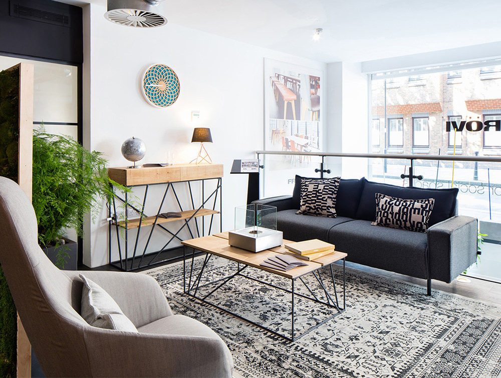 Snug Modern Sofa with Black Upholstered Finish and Coffee Table for Reception Areas