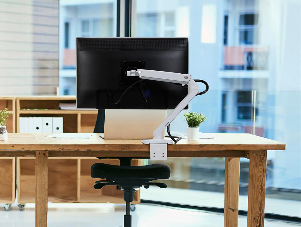 Ergotron MXV Desk Monitor Arm in White with Two Piece Clamp with Laptop and Wooden Desk