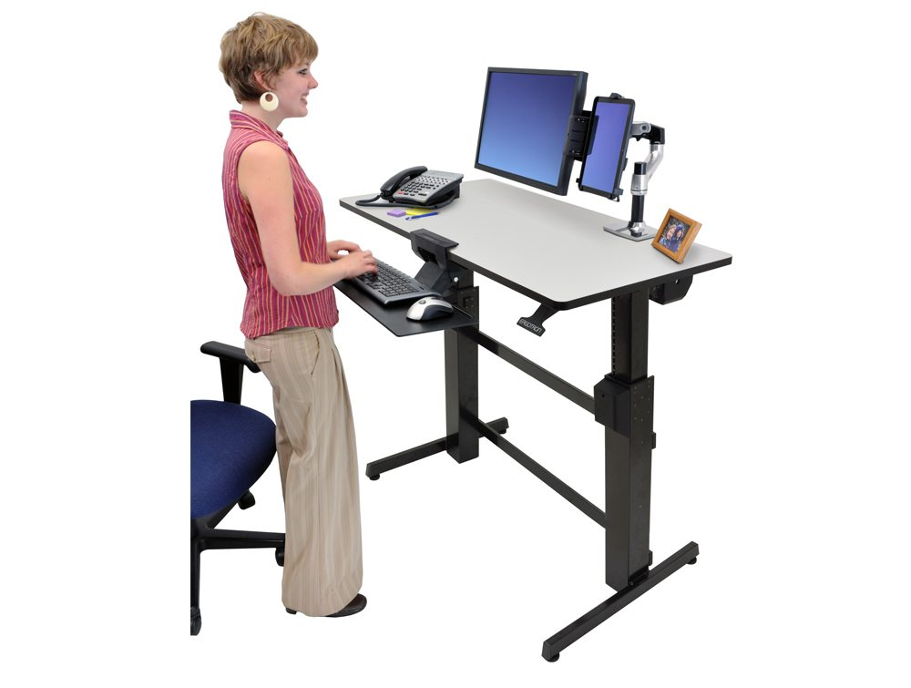 Ergotron WorkFit D Sit Stand desktop workstation with a user standing up
