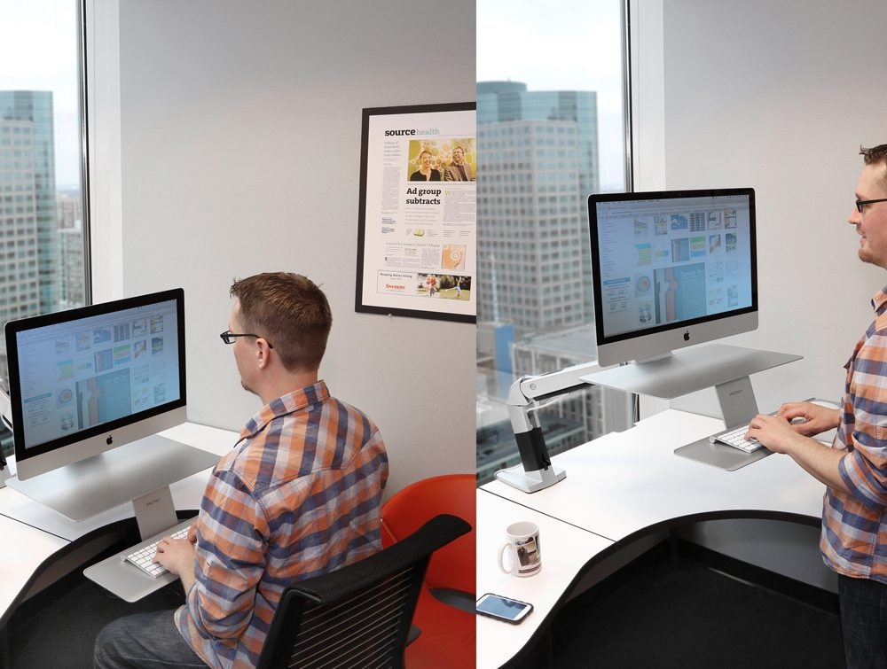 Ergotron WorkFit A Sit Stand Workstation for Apple with a user