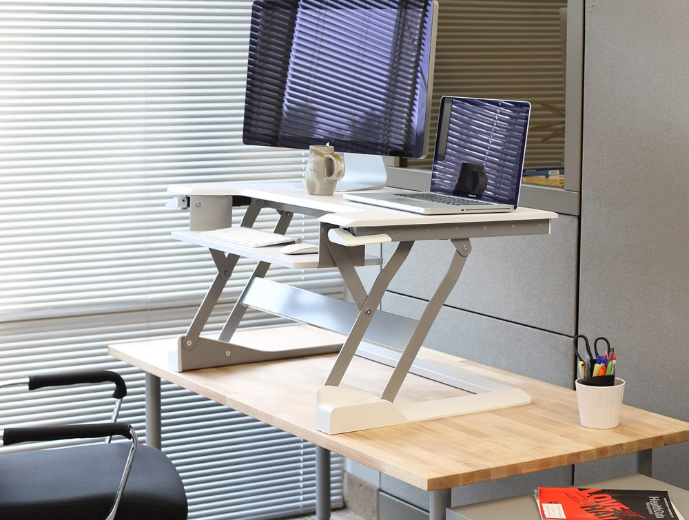 Ergotron WorkFit T Sit Stand desktop workstation in a table