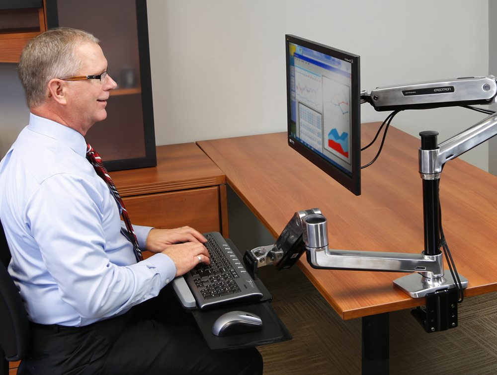 WorkFit LX sit stand desk mount system with user