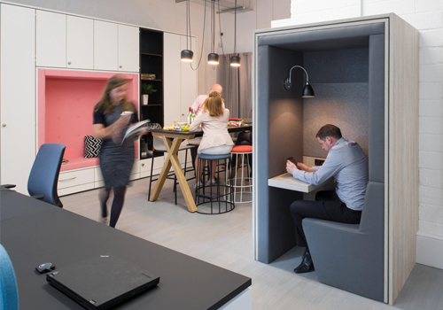 Acoustic-Phone-Booth-with-Seating-Area-and-Desk-and-Snugglestor-in-Breakout-Area