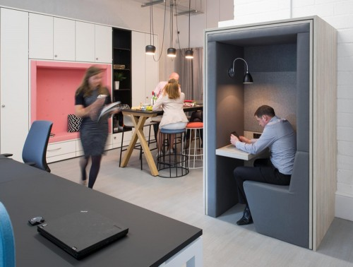 Acoustic-Working-Booth-with-Seating-Desk-Lighting-in-Grey-in-Communal-Space