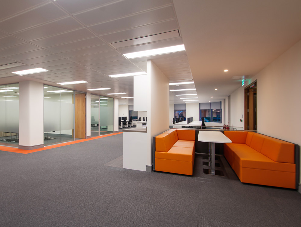 Apex Office Layout Orange Sofas with White Meeting Table