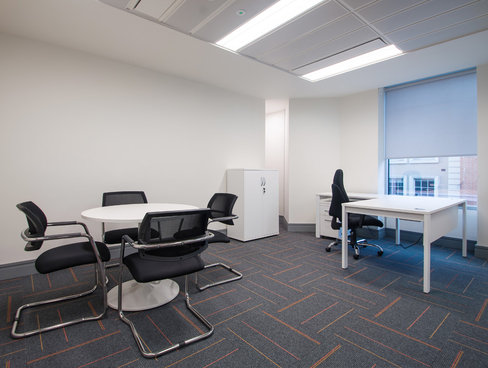 Apex Office Layout White Radial Desk with White Storage and Round Coffee Table with Black Meeting Chairs and Task Office Chair
