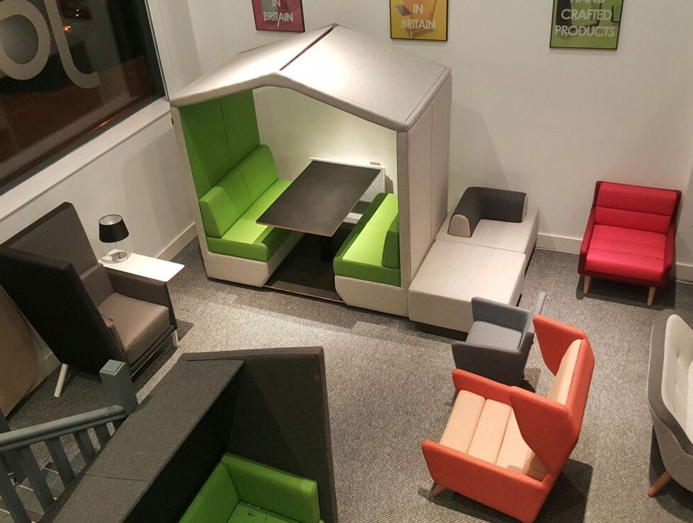 Bea 4 seater meeting pod with lush green cushion and overhead LED lights