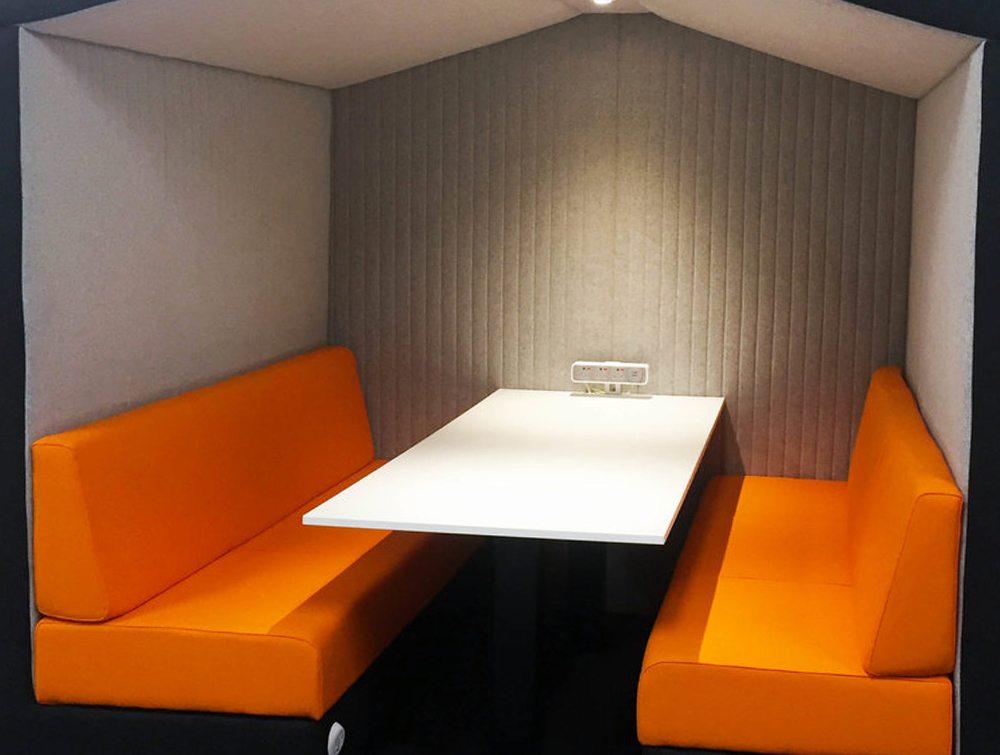 Bea 6 seater meeting pod with orange cushion and LED light interior