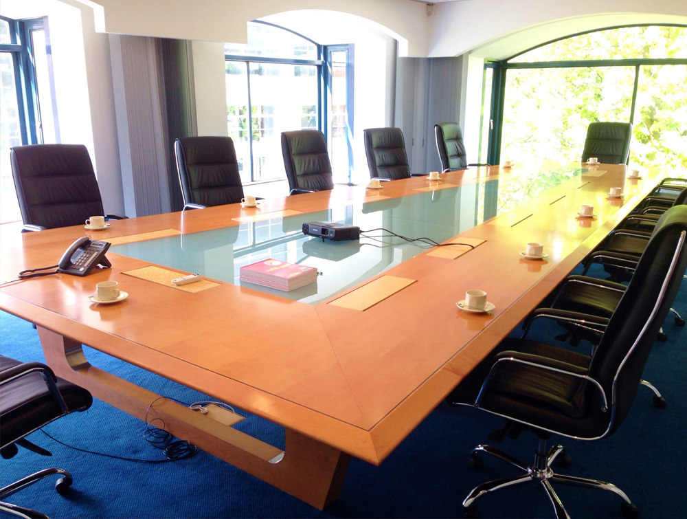 Glass boardroom table with 12 leather chairs Bespoke glass furniture