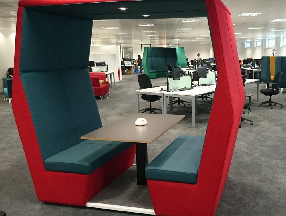 Bill meeting pods withoutwall in Office interiors with overhead led lights