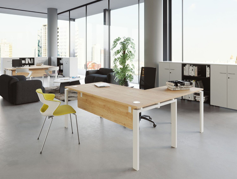 Buronomic Astro Desk for Open Space 2 in wood finish top with white legs in office with books on top.jpg