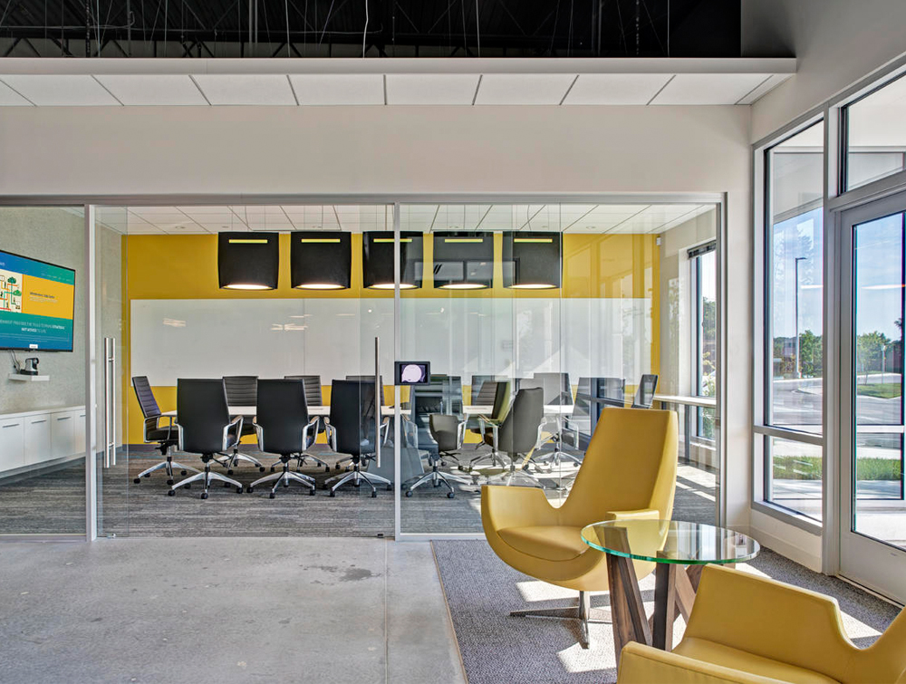 BuzziBell-Acoustic-Pendant-Ceiling-Light-Black-in-Office-Meeting-Room-with-Yellow-Armchair