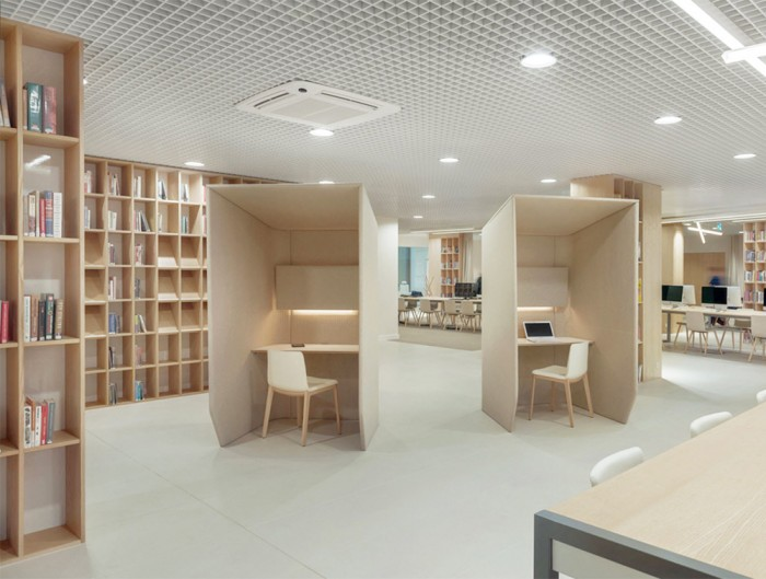 BuzziBooth-Single-Acoustic-Workstation-Pod-Beige-in-Library-with-White-Chair-and-Lights