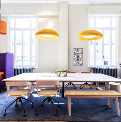 BuzziPicNic Desk 2 in Wood Finish with Yellow Ceiling Light and Bench in Breakout Area