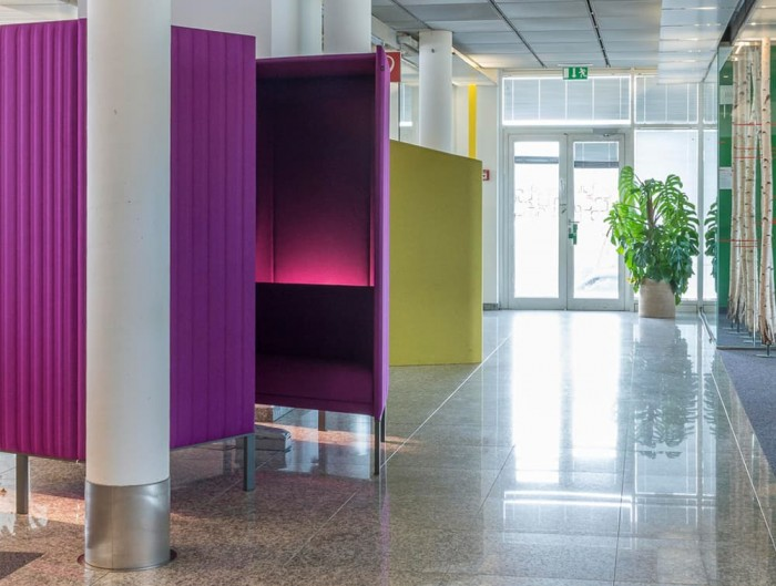 BuzziSpace-Hive-Acoustic-Meeting-Pods-Purple-with-Lights-in-Lobbies