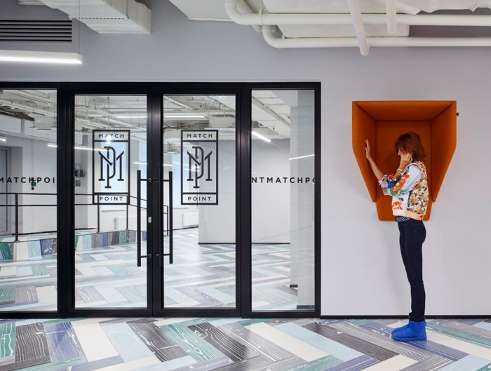 BuzziSpace-Hood-Wall-Mounted-Acoustic-Phone-Booth-Orange-in-Office