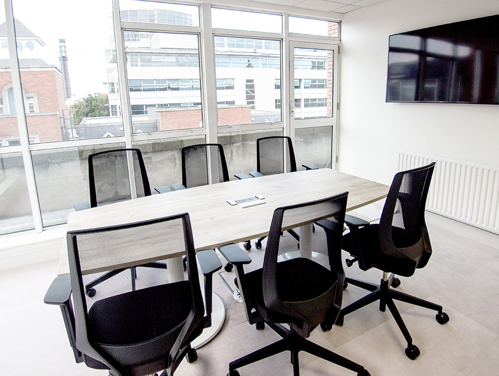 Conference Room with Mesh Chairs and TV Screen Embedded on Wall
