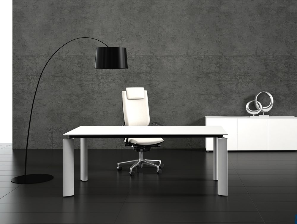 Crystal glass executive desk white top front angle in an office