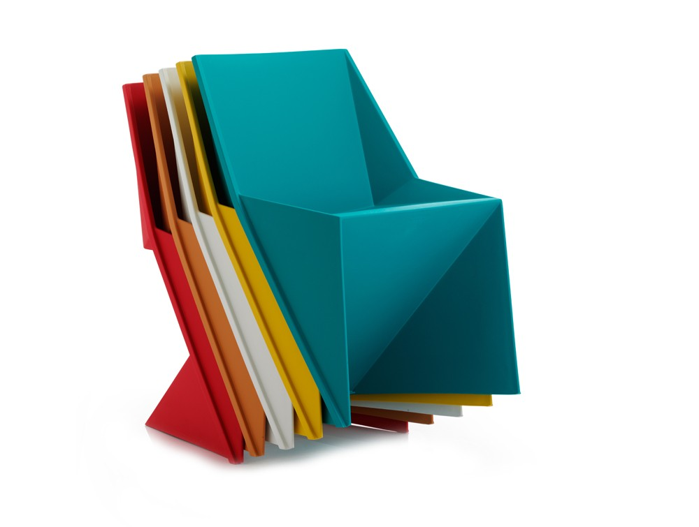 Dynamic freedom stackable chair in polypropylene chairs stacked together