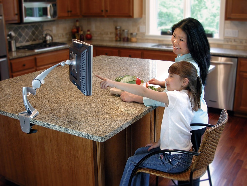 Ergotron neo flex LCD arm in a kitchen with users