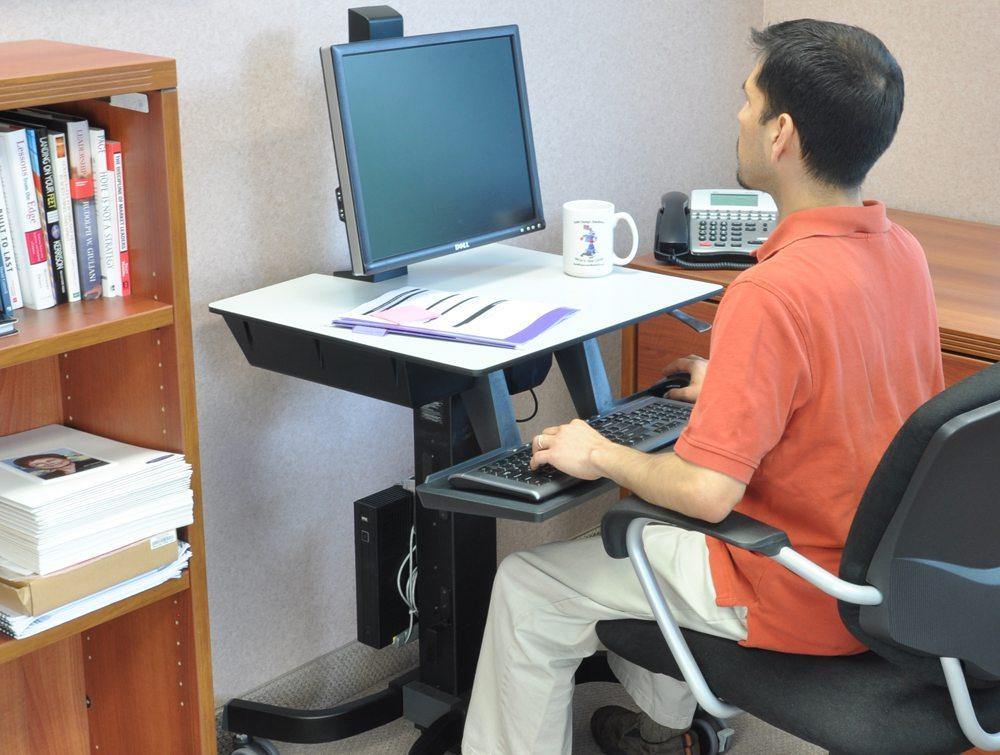 Ergotron WorkFit C Sit Stand Workstation seated