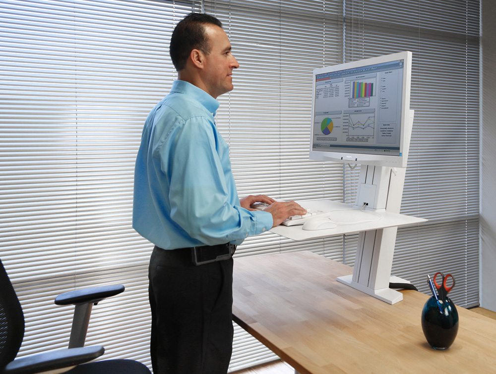 Ergotron WorkFit-SR Sit Stand Workstation being used
