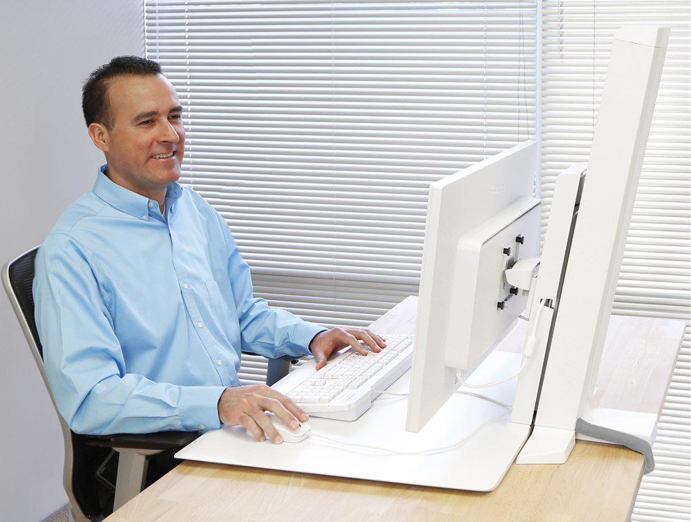 Ergotron WorkFit-SR Sit Stand Workstation sitting position
