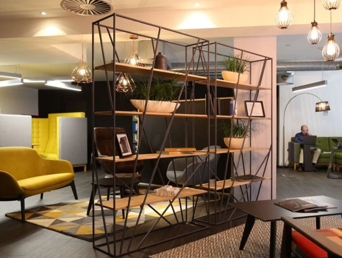 Foundry Rustic Tall Wooden and Metal Palisade in Reception Area