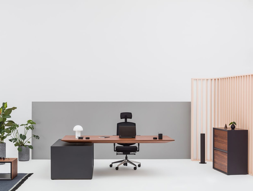 Gravity-Electric-Sit-Stand-Executive-Manager-Desk-with-Side-Storage-with-Wood-Finish-Table-and-Graphite-Storage-Base-in-Office-Showroom