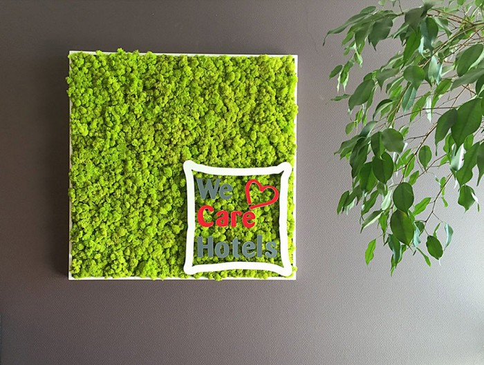 Green-Moss-Personalised-Logo-and-Letterings-We-Care-Hotels