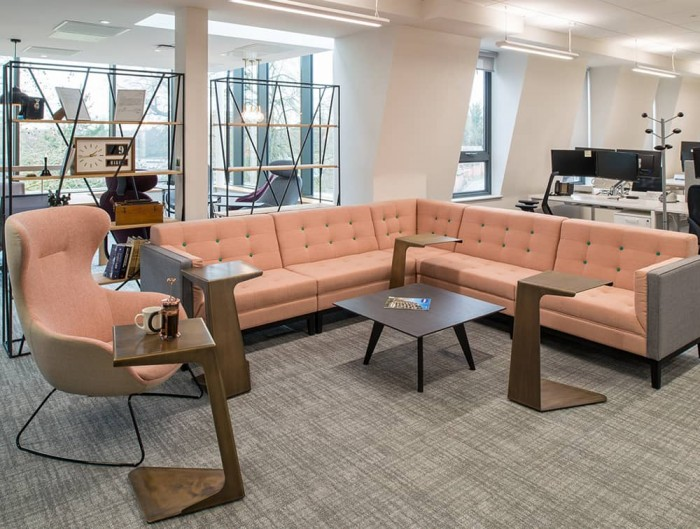 Jig Modular Low Back Soft Seating Range in Pink in Open Office Space with Foundry Metal Palisades