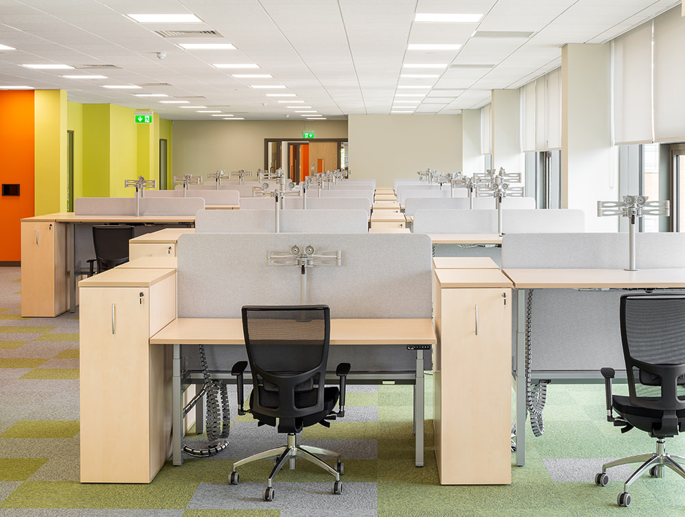 Leap Adjustable Desks with Acoustic Desk Dividers Ergonomic Monitor Arms and OZ Mesh Office Chairs