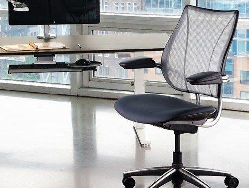 Liberty Mesh Ergonomic Chair Next To Desk and Windows