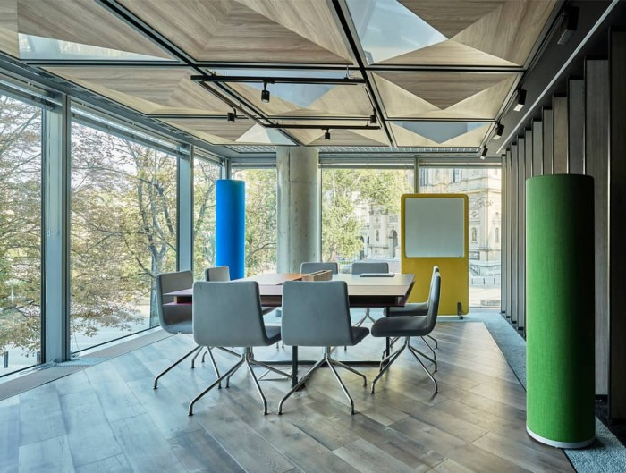 MuteDesign Wall Standing Acoustic Screen in Yellow with Wheels and Tower in Meeting Room
