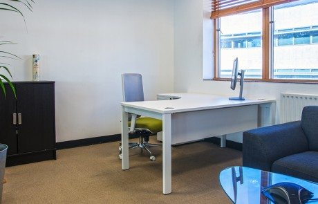 Office with radial desk armchair and storage unit