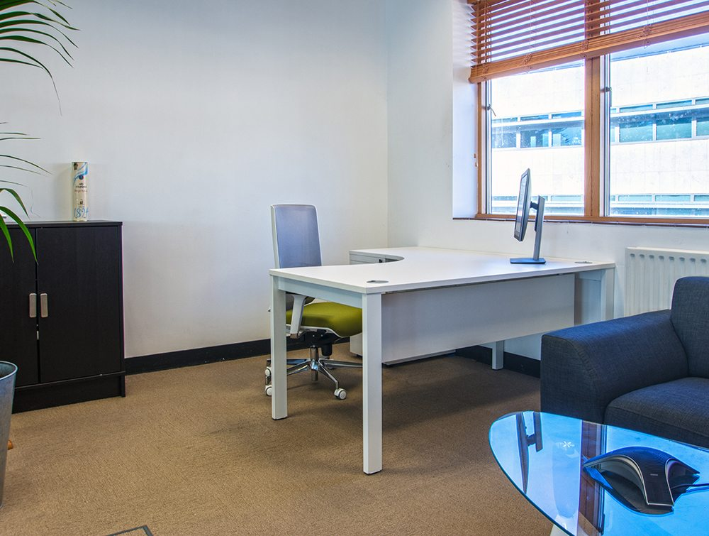 An office table: radial corner desk white colour
