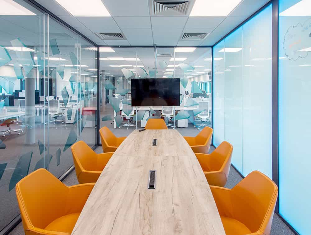 One-View-Conference-room-with-Profim-orange-tub-chairs-and-Barrel-Shaped-Meeting-Table