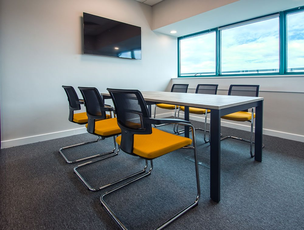 Meeting room with chairs in orange colour