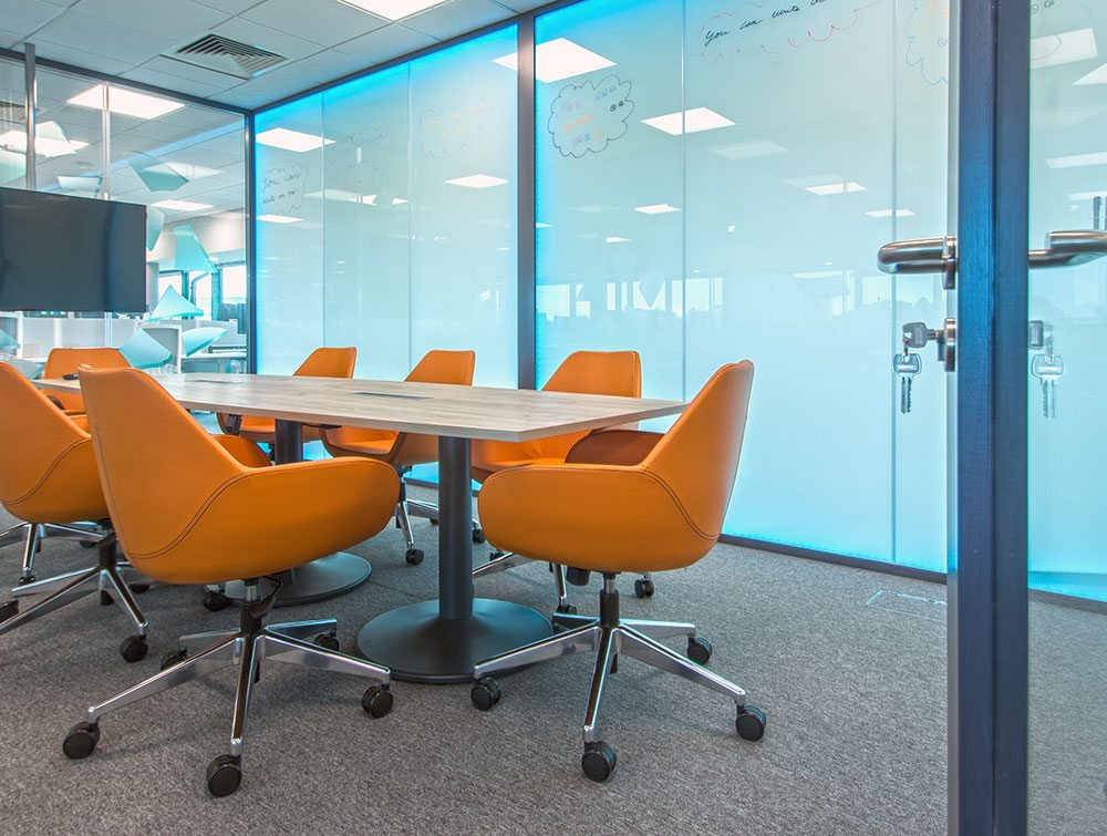 orange office chairs in a boardroom