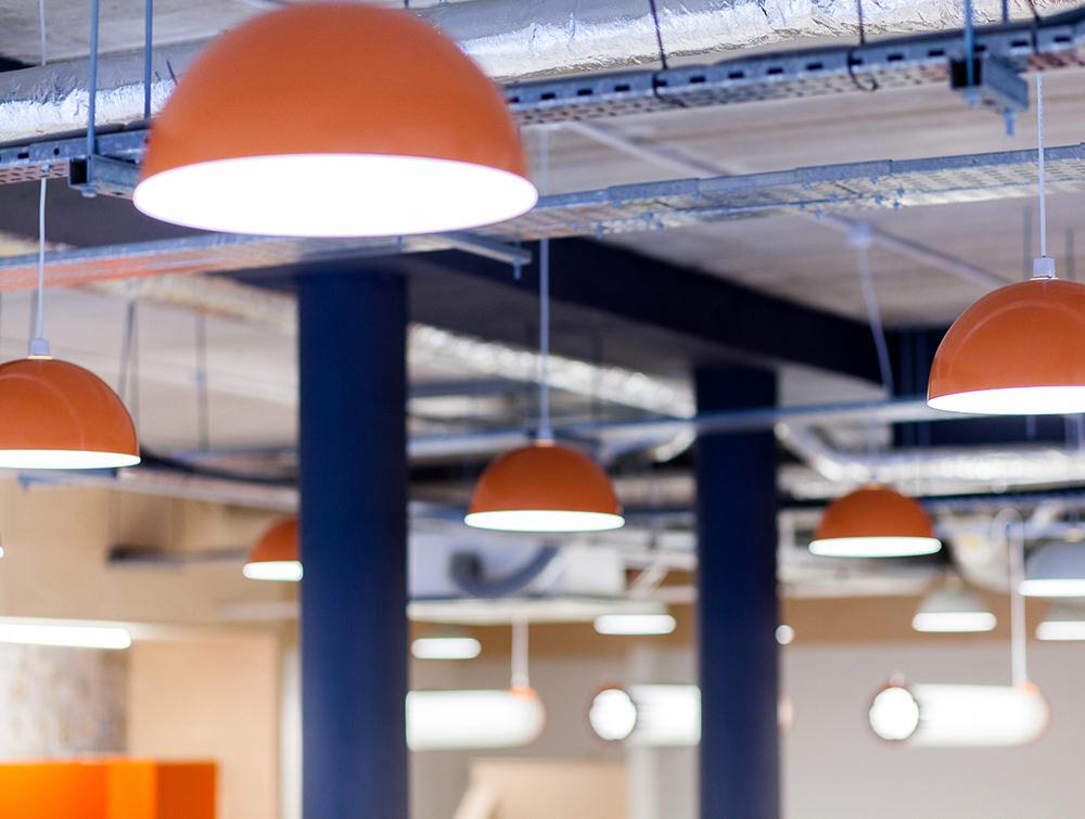 Big orange ceiling lights and blue columns