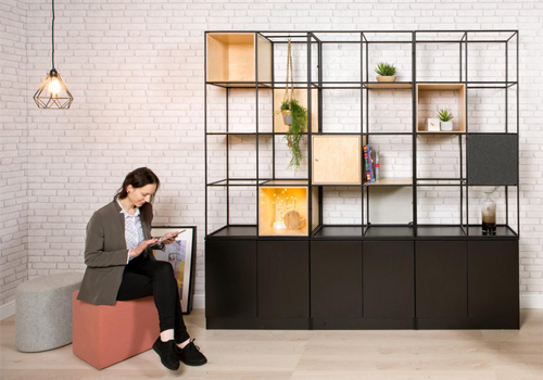 Palisade-Metal-Grid-Office-Space-Divider-with-Low-Storage-with-Light-Pouffes-Plants