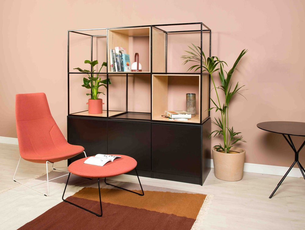 Palisades-Metal-Grid-Built-In-Cabinet-Bookcase-Shelves-with-Lounge-Red-Chair-and-Small-Round-Table