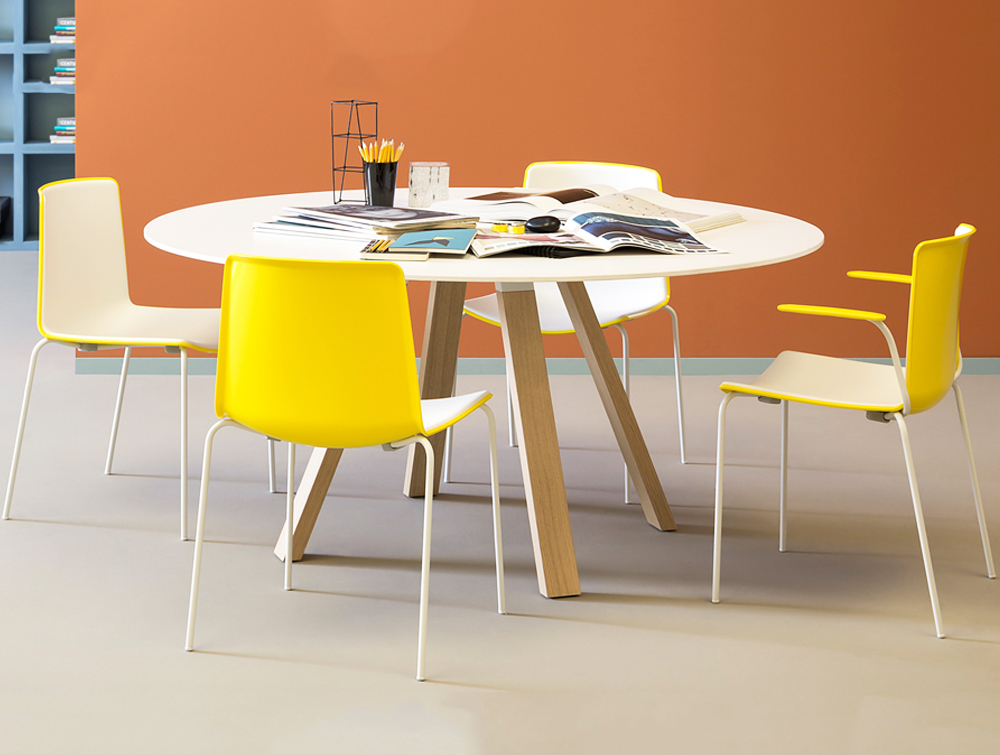 Pedrali Arki Round Table with Steel Trestle Legs 2 in White Top Finish with Yellow Chair in Cafeteria.jpg