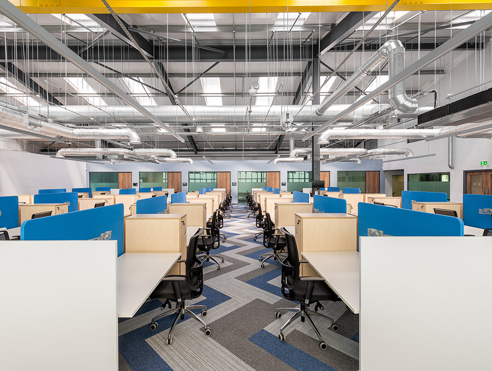 Precision Office Sit Stand Desks with Acoustic Screens and Ergonomic Black Chairs Design and Layout by Radius Office